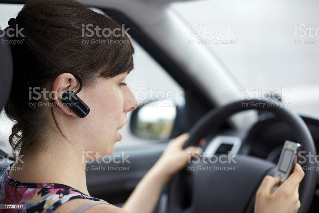 calling with bluetooth headset and driving car royalty-free stock photo