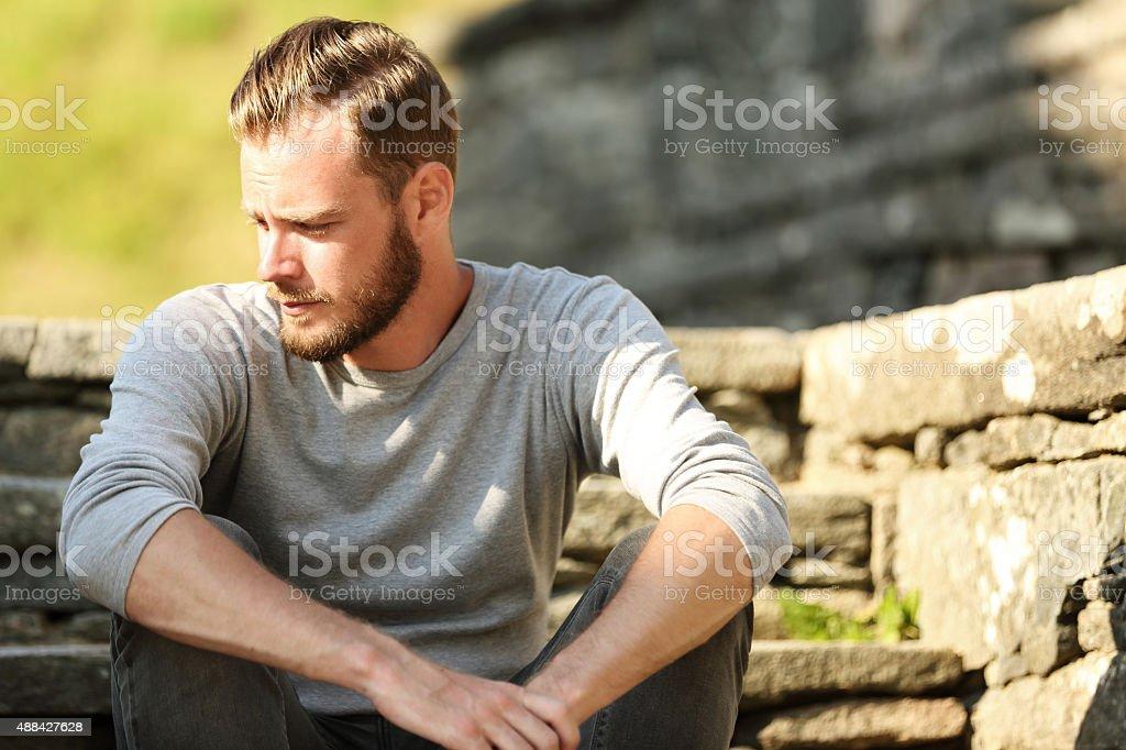 Calm attractive sitting down stock photo