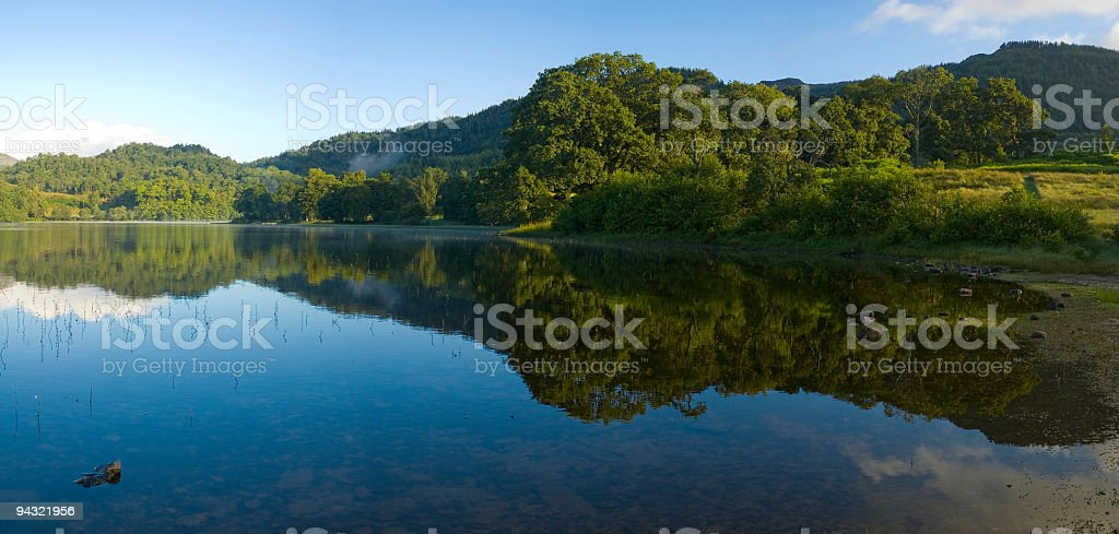 Calm blue lake royalty-free stock photo