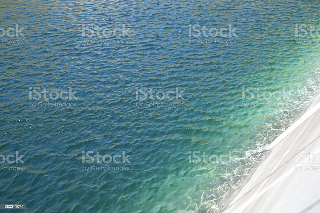Calm blue water surface stock photo