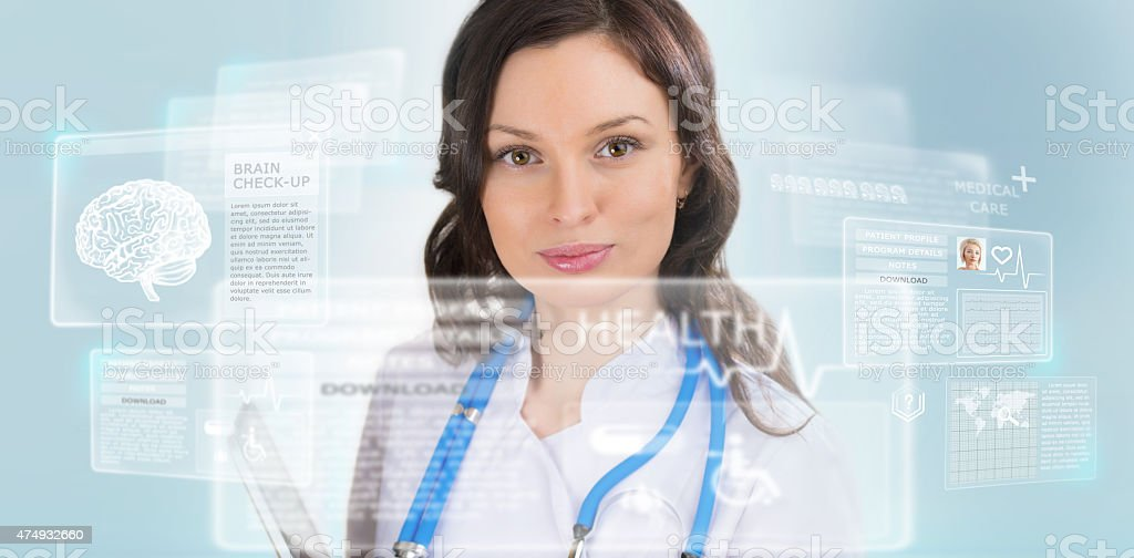Calm doctor touching a medical interface in the hospital stock photo