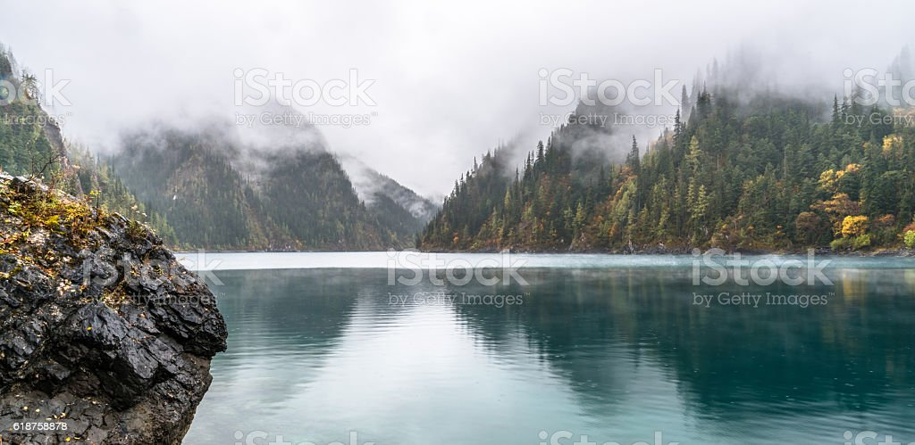 Calm forest smooth lake with reflections, china juzhaigou stock photo