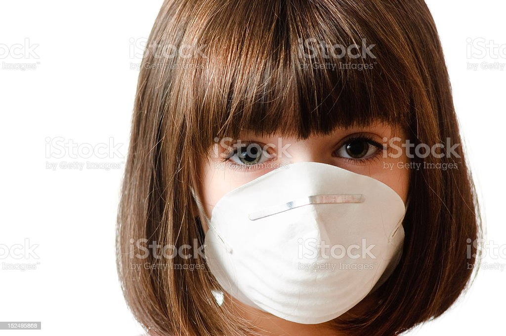 Calm girl wearing a particle mask stock photo
