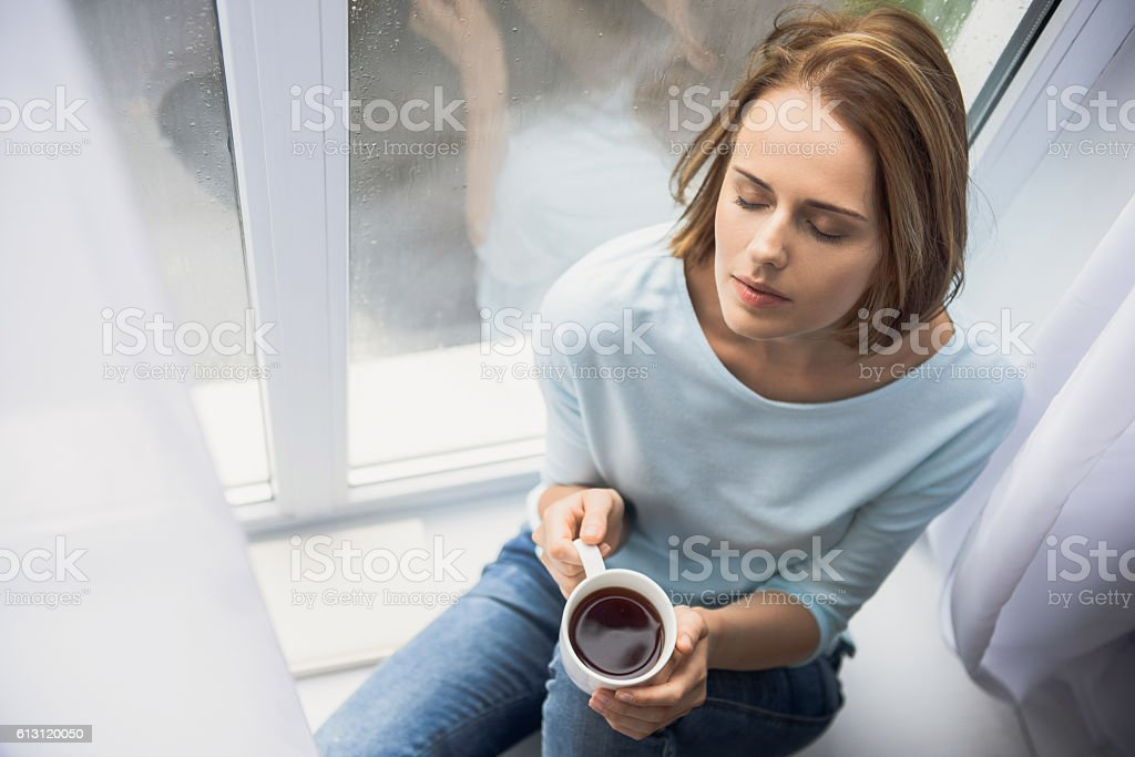 calm girl with cup of tea stock photo