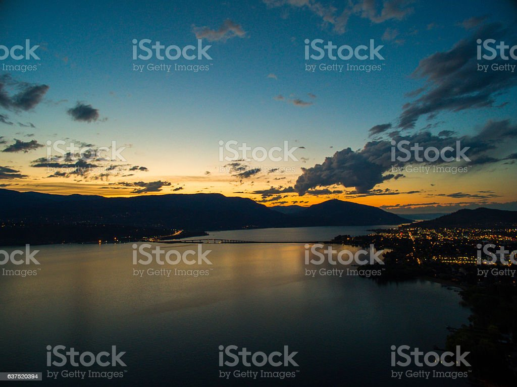 Calm Lake and Bridge at Dusk stock photo