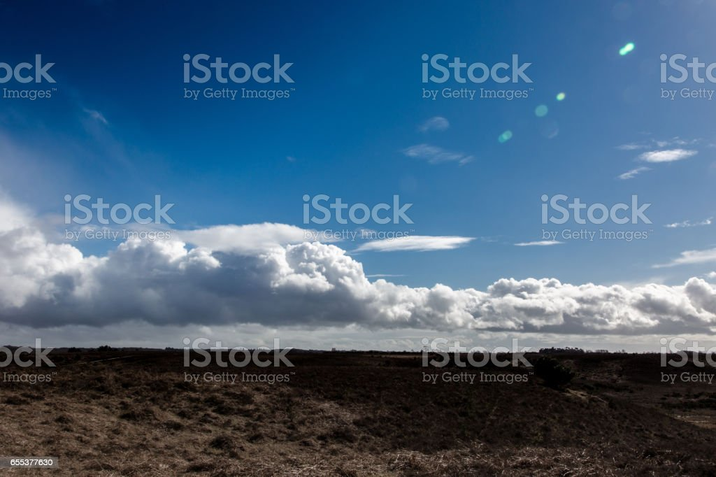 Calm landscape with low clouds on blue sky stock photo