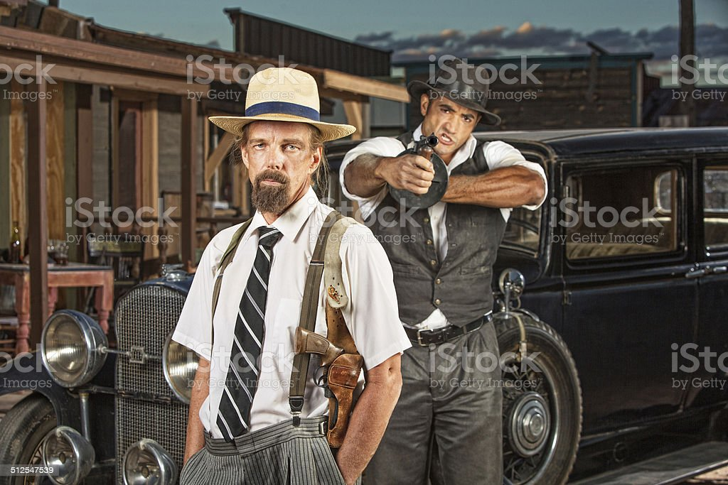 Calm Mobster with Guard stock photo