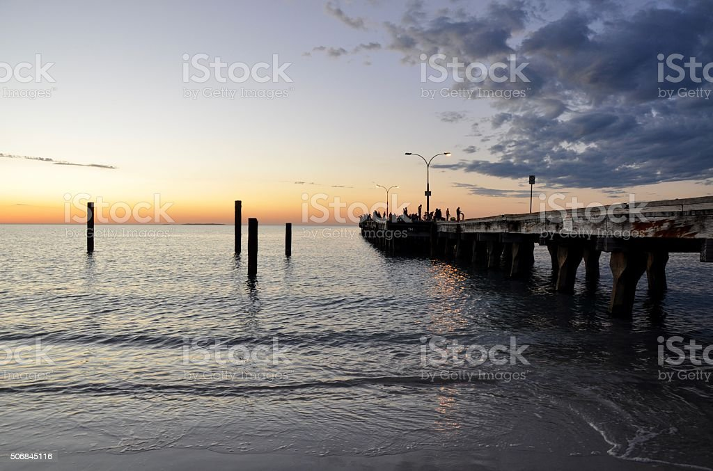 Calm Ocean Waters at Sunset with Jetty stock photo