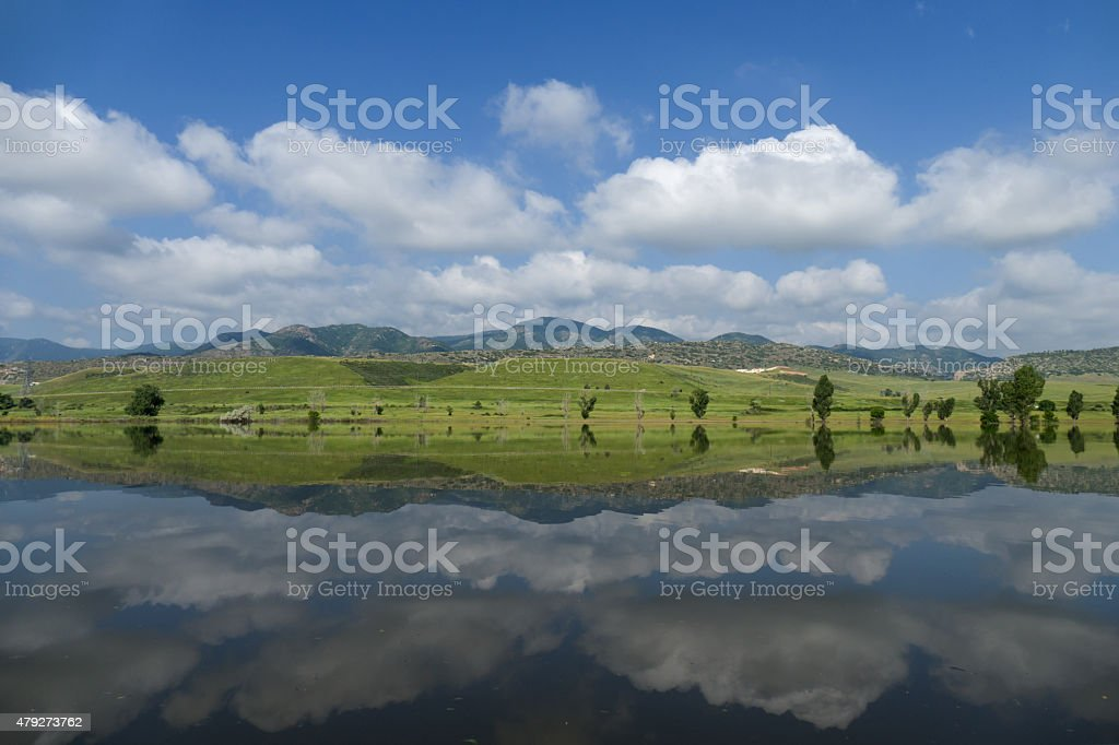 Calm reflection Chatfield State Park waters and Colorado mountains stock photo