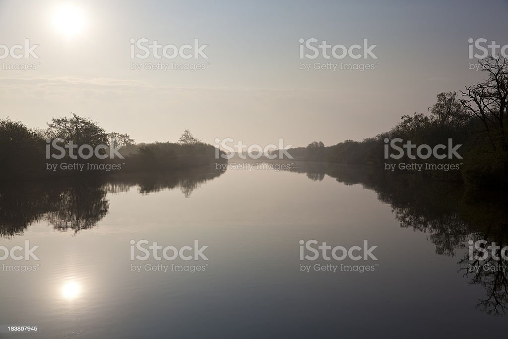 Calm river early morning landscape in Norfolk, UK royalty-free stock photo