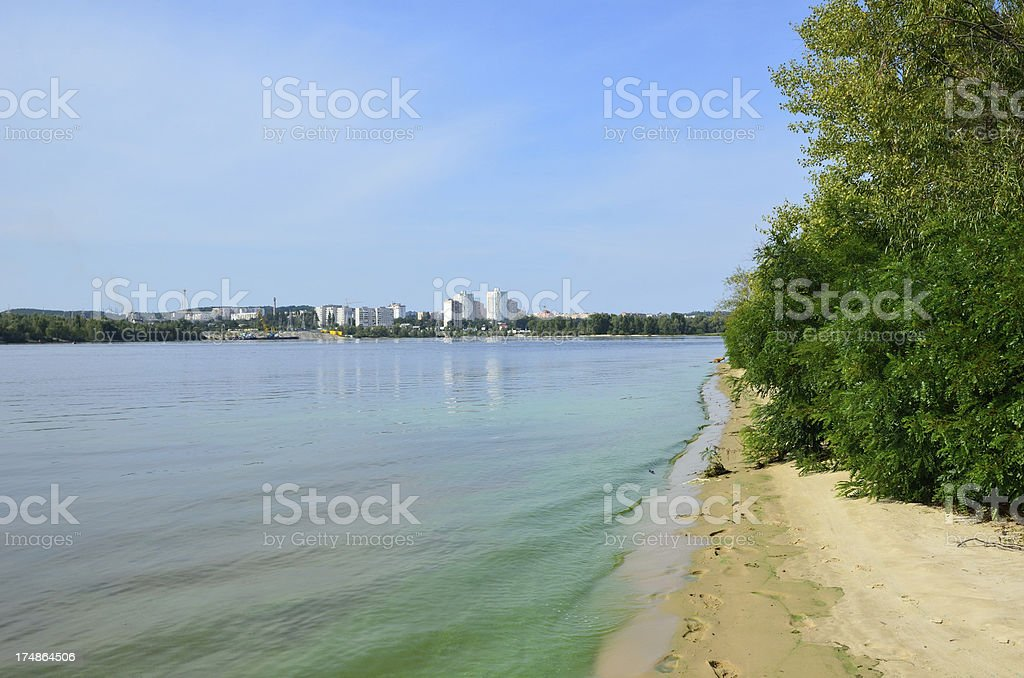Calm river with green riverbank royalty-free stock photo