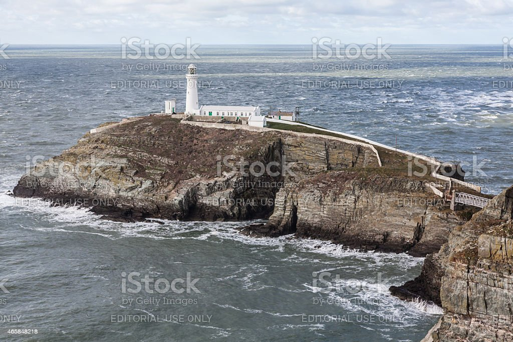 Calm sea surounds South Stack Lighthouse stock photo