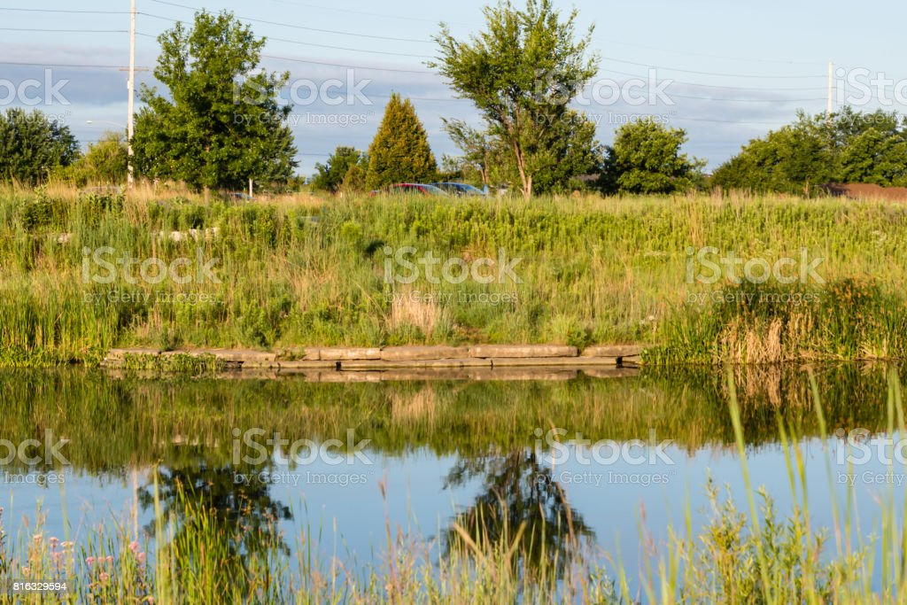 calm spot to fish at the local pond stock photo