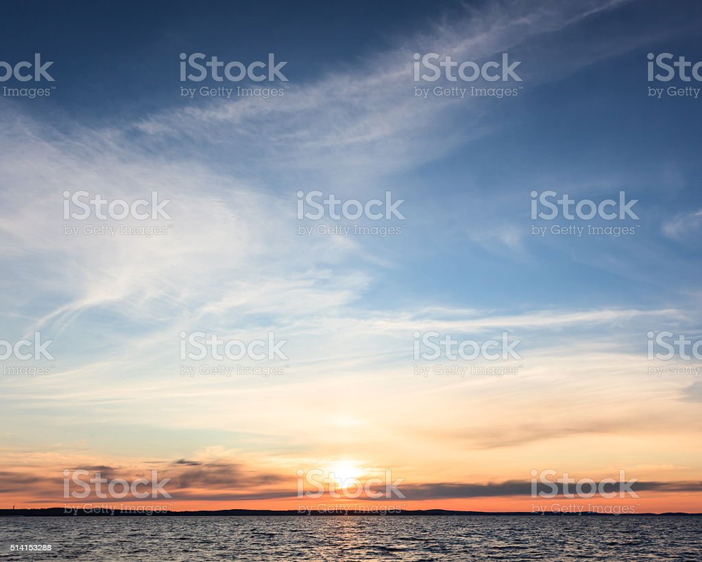 Calm sunset and clouds over lake stock photo