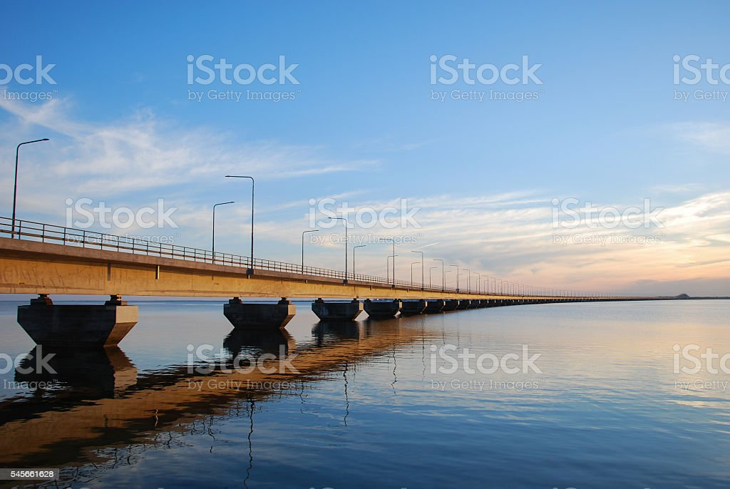 Calm water by the bridge stock photo