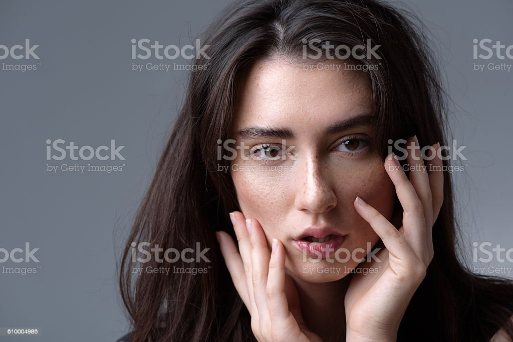calm woman looking into camera stock photo