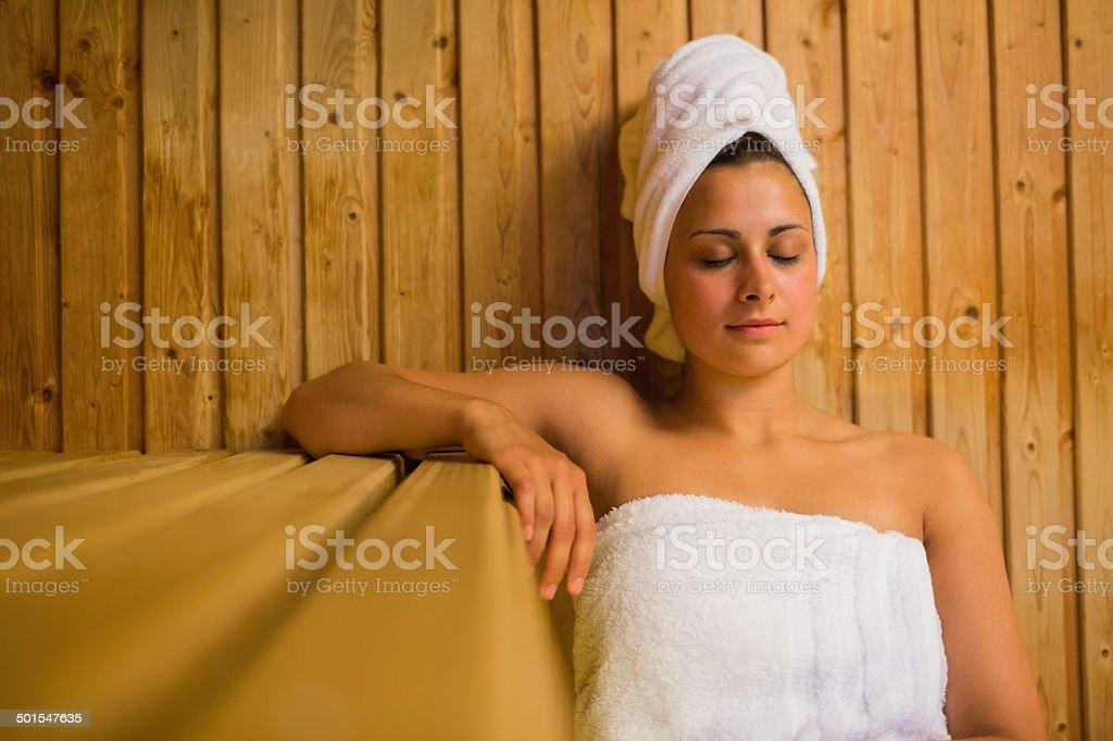 Calm woman relaxing in a sauna stock photo