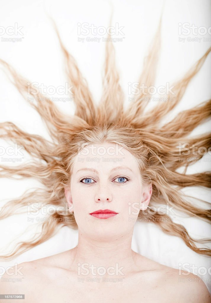 Calm woman with blue eyes stock photo