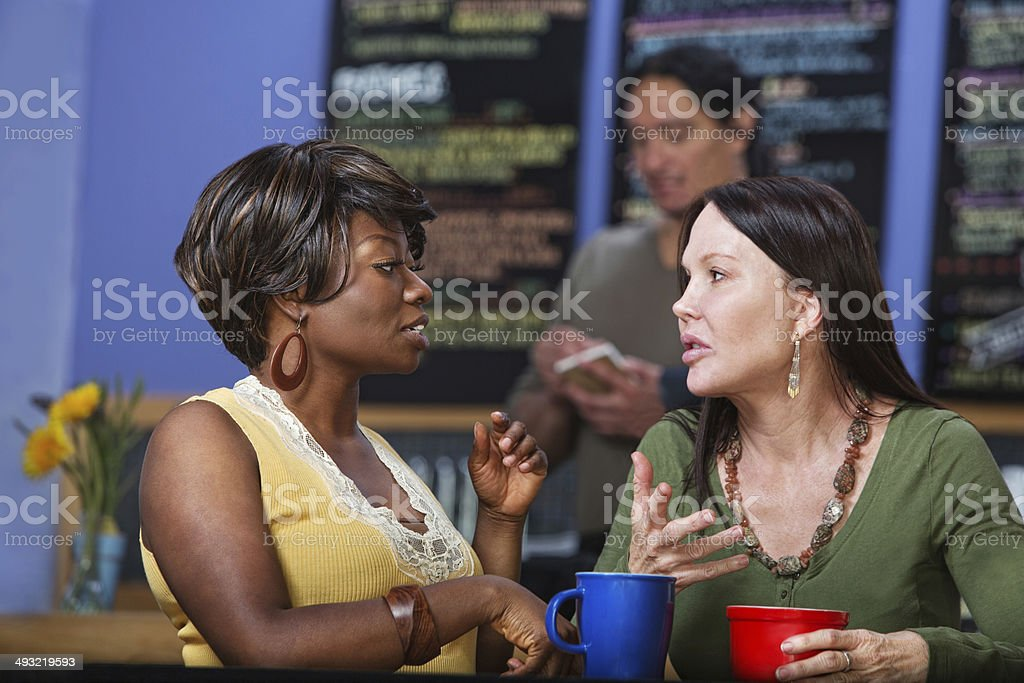 Calm Women in Conversation royalty-free stock photo