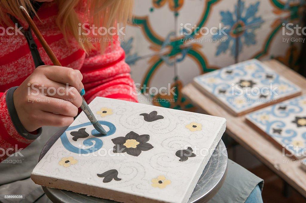 Caltagirone pottery decorator stock photo