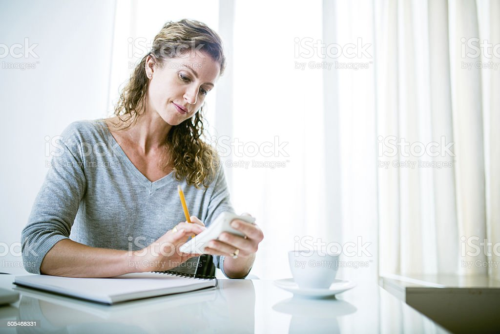 Calulating Bills and Taxes stock photo