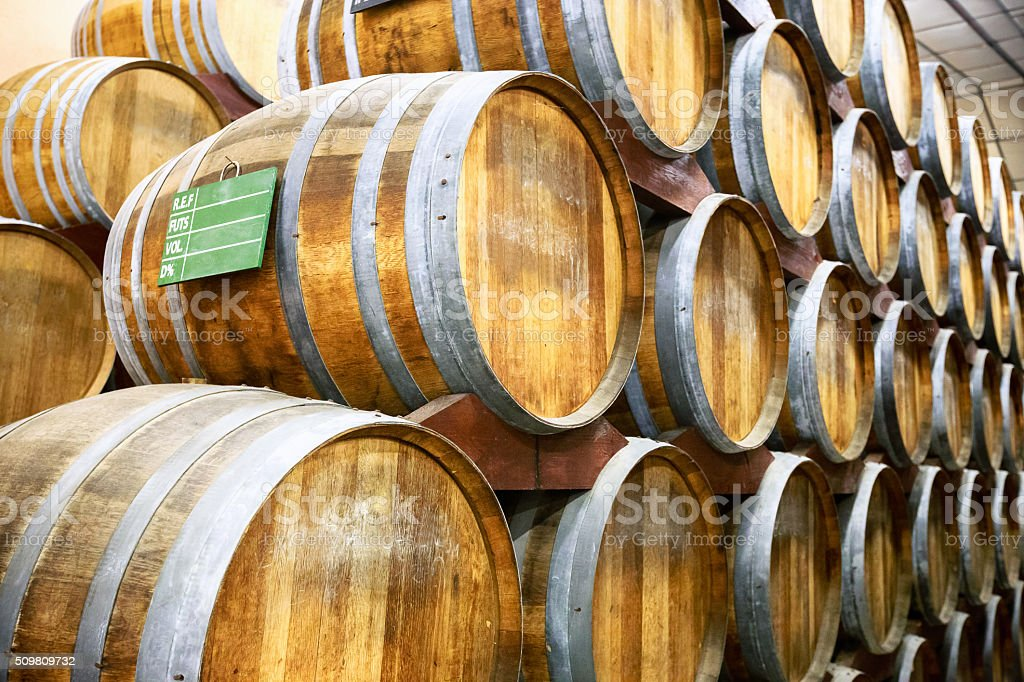Calvados barrels in storage at the plant in Normandy, France stock photo