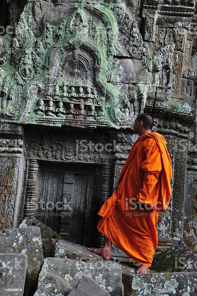 Cambodia Angkor monk in Ta Prohm temple royalty-free stock photo