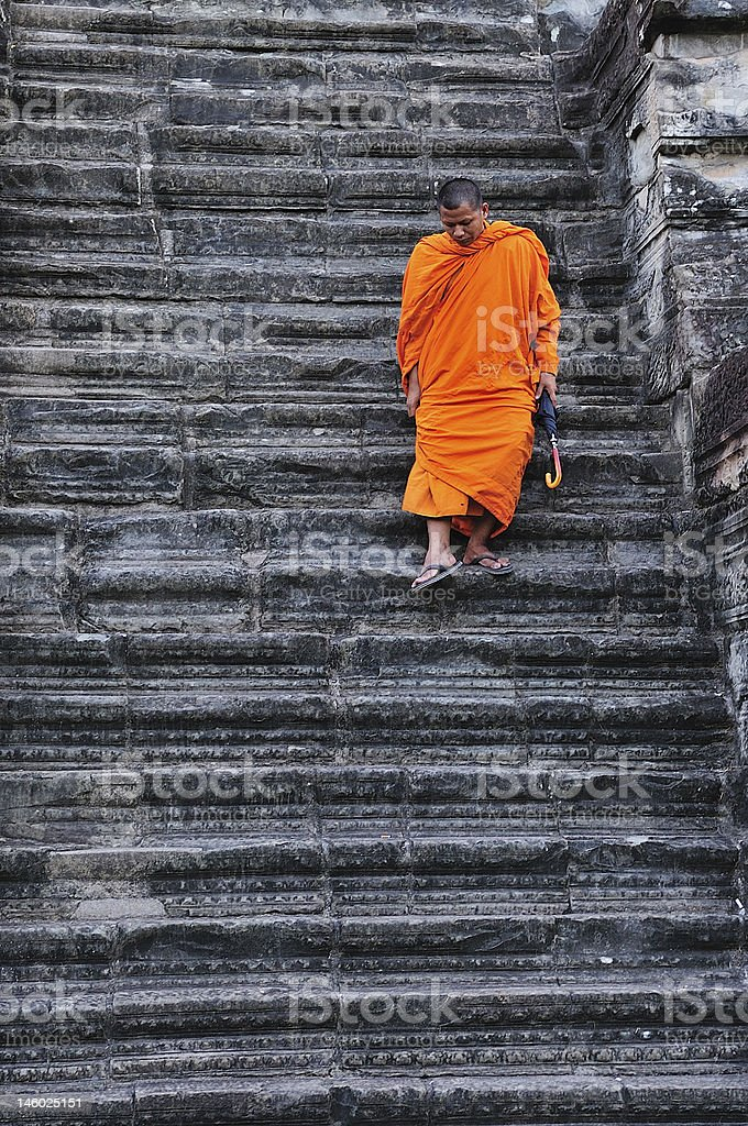 Cambodia monk in the stairs royalty-free stock photo
