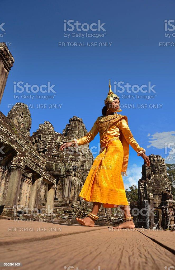 Cambodian dancer walking in Angkor-Tom stock photo