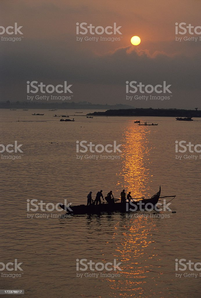 Cambodian Fishing Boat at Sunrise stock photo