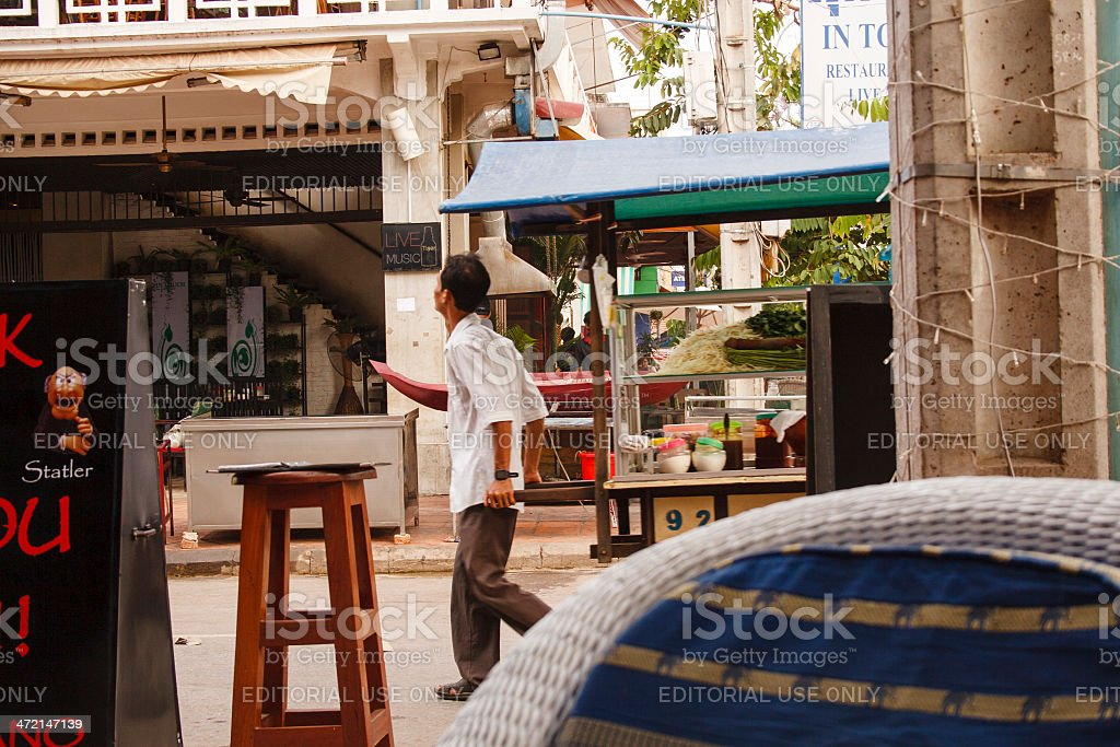 Cambodian man sells food on a street stock photo