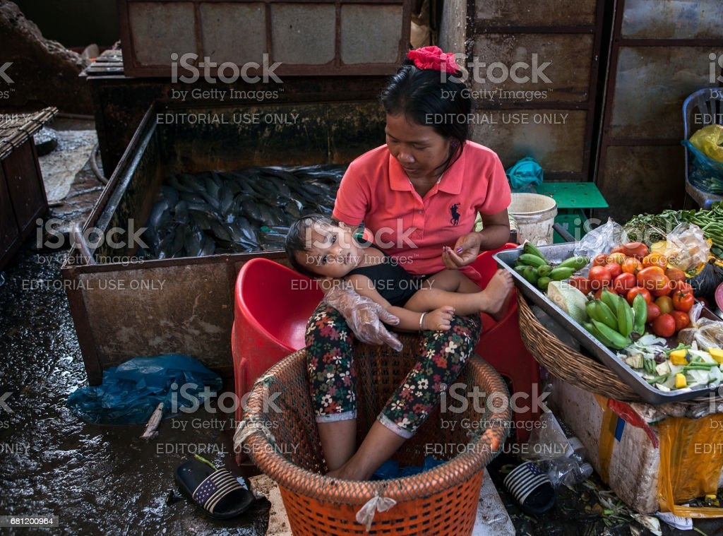 A Cambodian woman and her baby boy stock photo