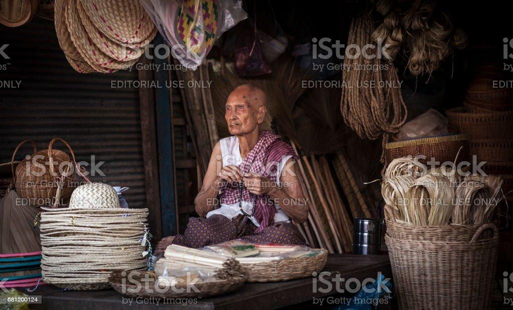 Cambodian woman selling bamboo basket at market stock photo