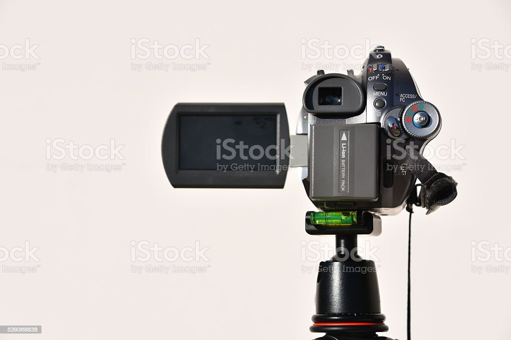 Camcorder on a tripod stock photo