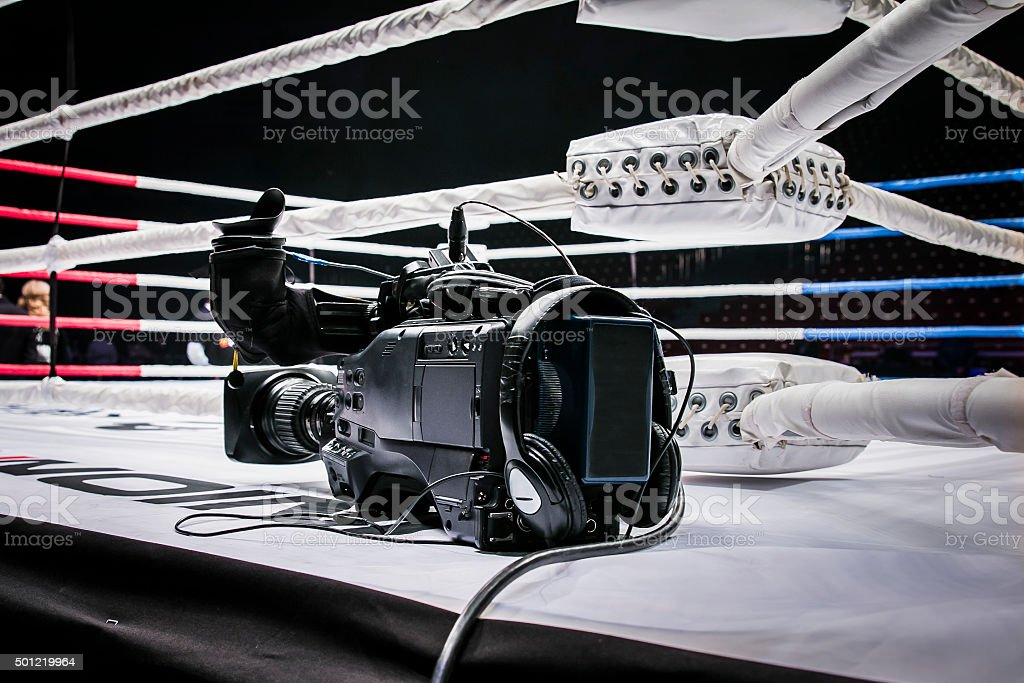 camcorder stands on corner ring for mixed martial arts stock photo