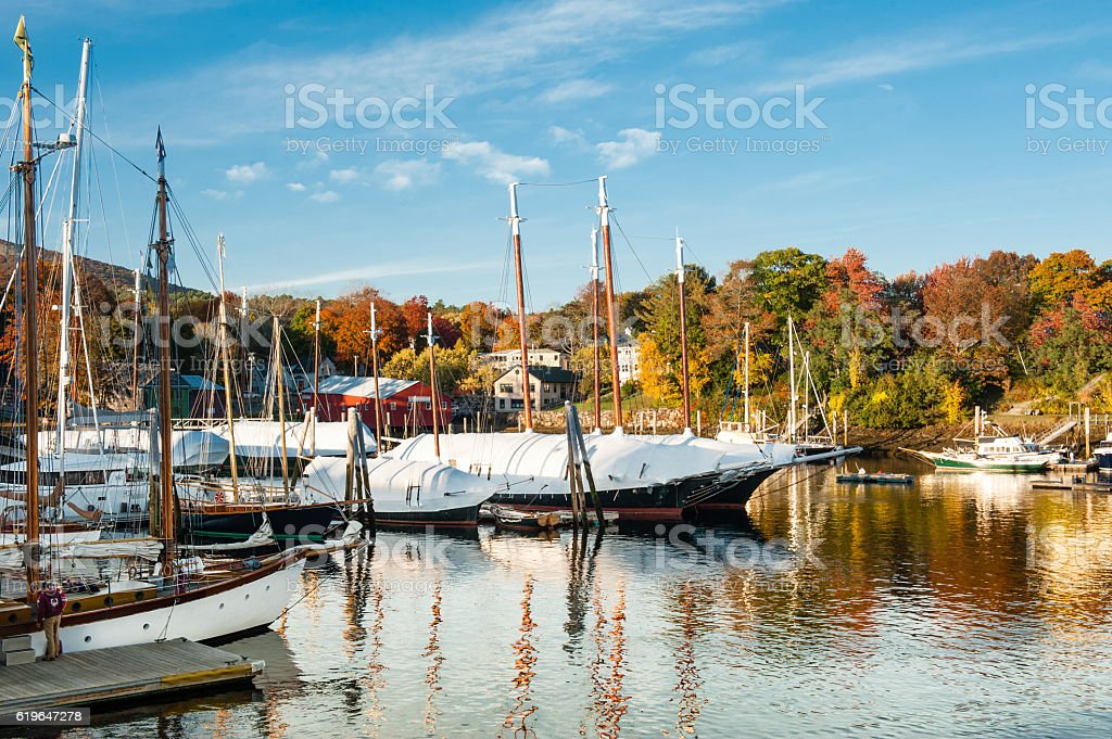 Camden, Maine harbor with bright fall foliage in autumn stock photo