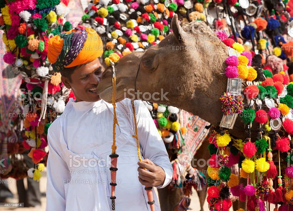Camel and his owner attends at traditional camel decoration competition stock photo
