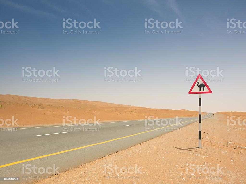 Camel Crossing Sign Empty Desert Highway stock photo