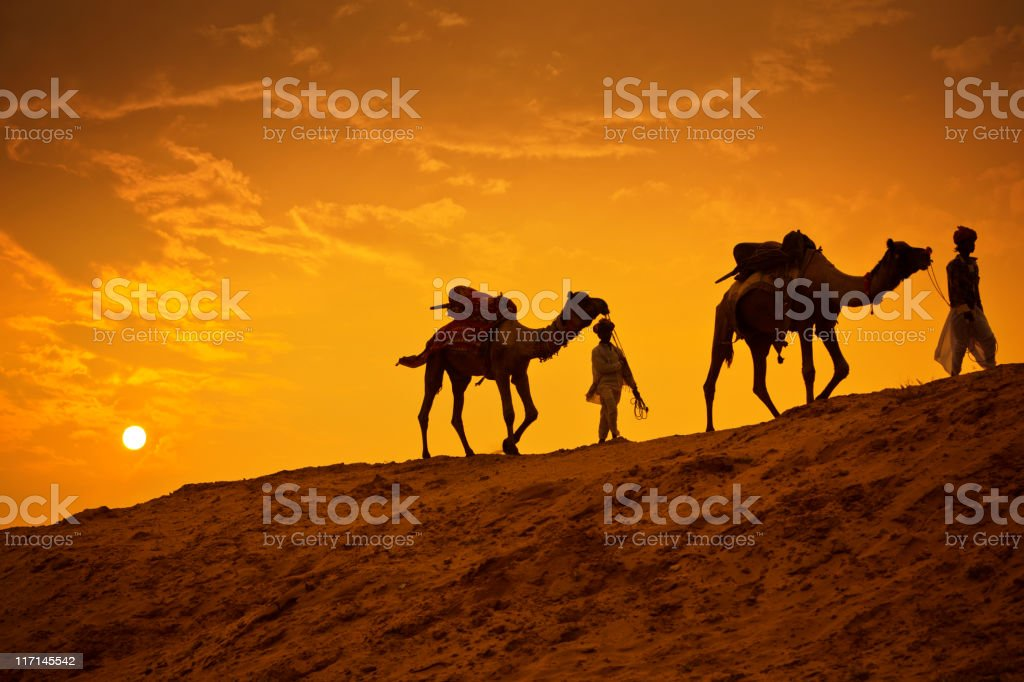 Camel Riders in the Desert royalty-free stock photo