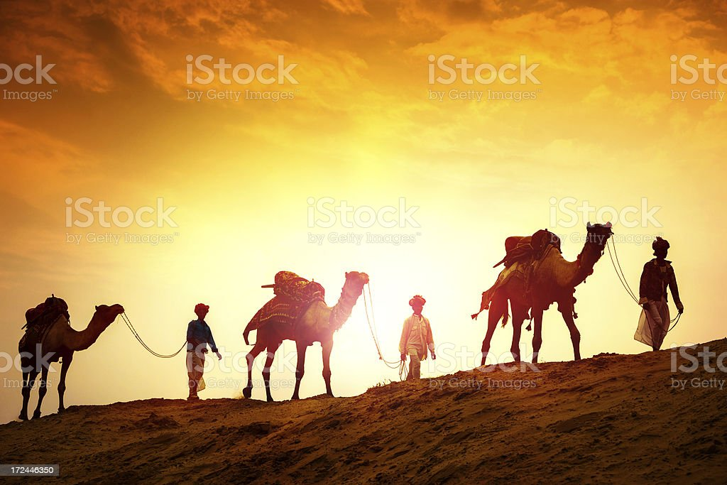 Camel Riders in the Desert stock photo