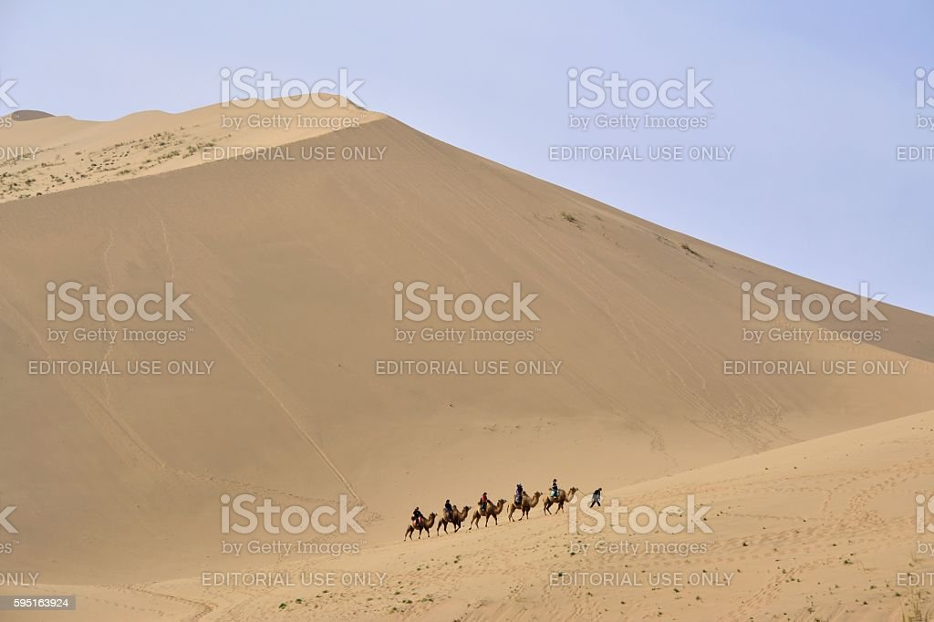 Camel riding in Badain Jaran desert, Inner Mongolia stock photo