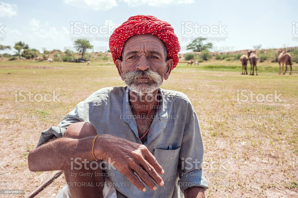 Camel shepherd in the Thar desert Rajasthan India stock photo