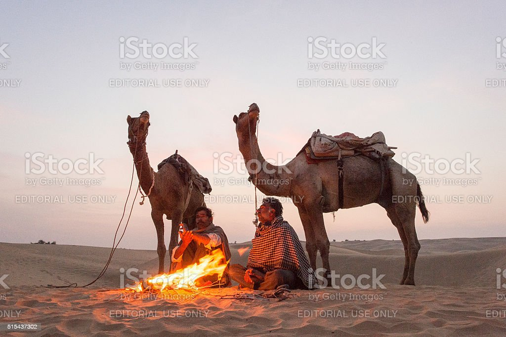 Camel Trader   in the Thar Desert during sunrise. stock photo