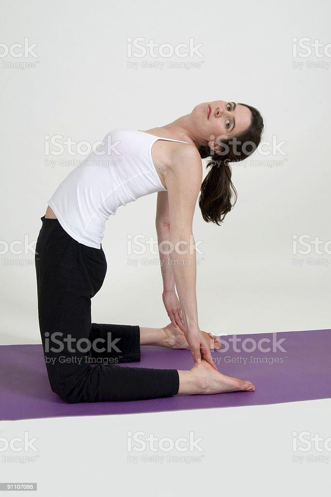 Camel yoga pose royalty-free stock photo