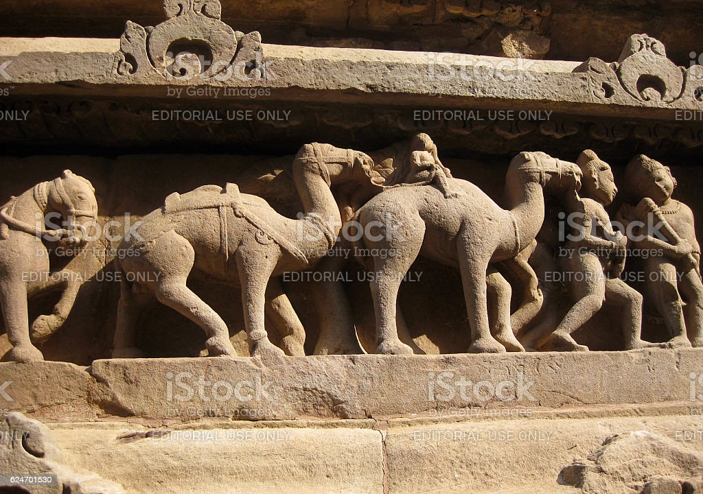 Camels and human figures on temple of Khajuraho stock photo