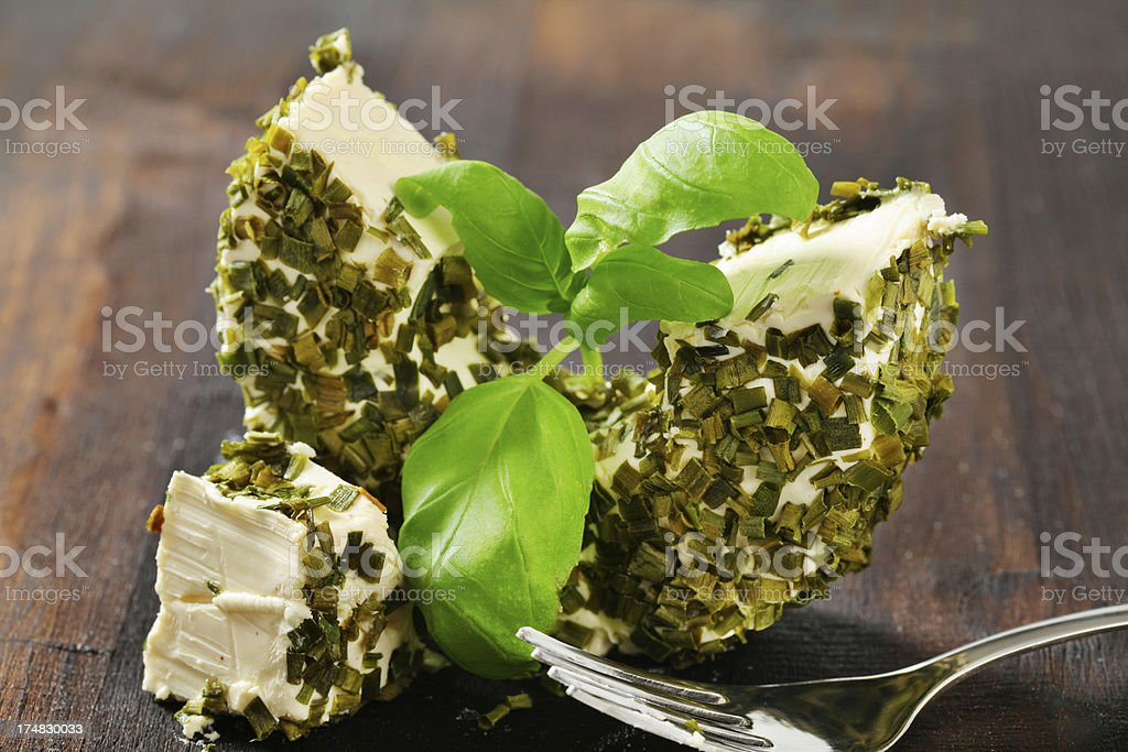 Camembert cheese coated in basil and spice royalty-free stock photo