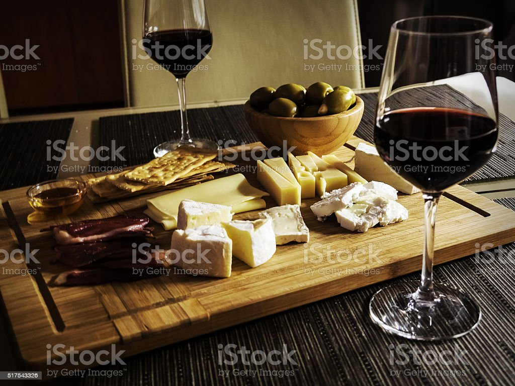 Camembert, Gouda And Brie Cheese Platter With Wine stock photo