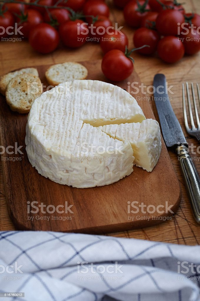 Camembert on wooden table stock photo