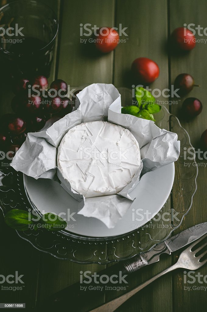 Camembert with grapes and tomatoes stock photo