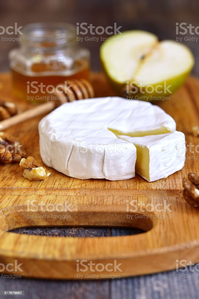 Camembert with honey,walnuts and pear. stock photo